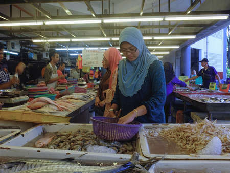 city fish market sign: Shah Alam, Malaysia - February 1: Unidentified people spent their time during Federal Teritorry Day, buying fresh seafood at Section 6 wet market in Shah Alam on 1st February 2016