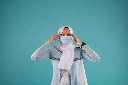 Fashion portrait of young beautiful asian muslim woman with wearing hijab.