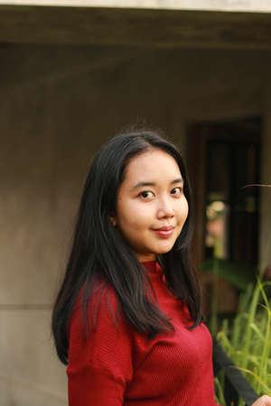 Young beautiful woman wearing red casual t-shirt. Stock Photo