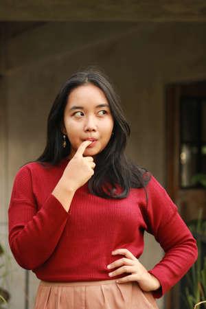 Young beautiful woman wearing red casual t-shirt.