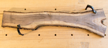 Bark edge rough sawn walnut board on traditional workbench