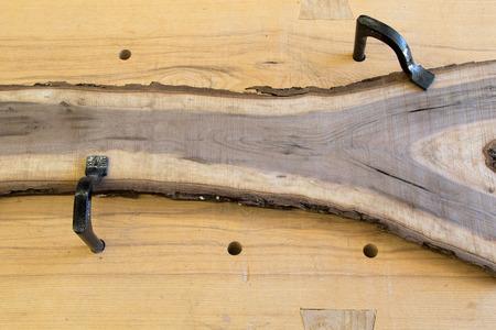 Bark edge rough sawn walnut board on traditional workbench Stock fotó - 89130288