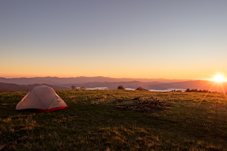 Tent on huckleberry knob overlooking appalachian mountains at sunrise