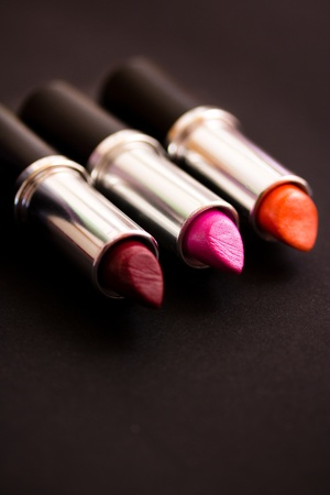 a still life of some colourful lipsticks