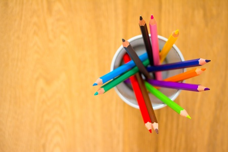 a shot of some colourful pencils on wood background Stock Photo - 10602450