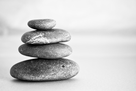depict: a shot of black stones to depict the concept of balance and zen