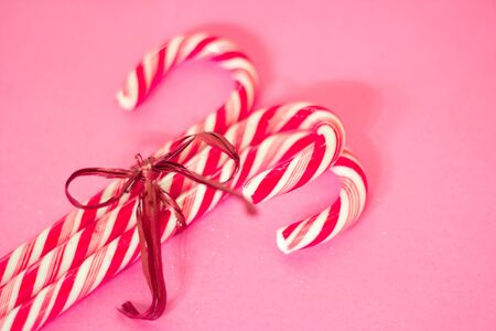 candy canes and Christmas ornaments with shallow depth of field