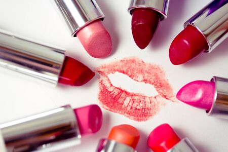 lipstick kiss mark: set of many colors of listicks in circle around lipstick kiss mark Stock Photo