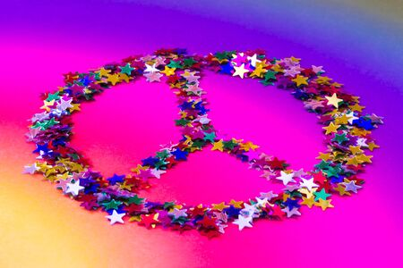 symbols metaphors: symbol of peace made up of colorful stars Stock Photo