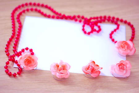empty card to place text surrounded by flower and necklace Stock Photo - 12957126