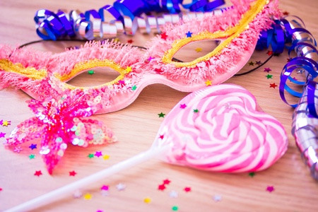 partycarnival objects: mask, confetti, lollipop photo