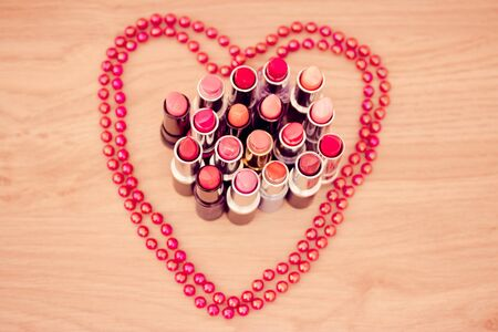 lipsticks colors with necklace in shape of heart Stock Photo - 12957239