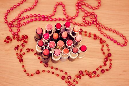 lipsticks colors with red necklaces photo