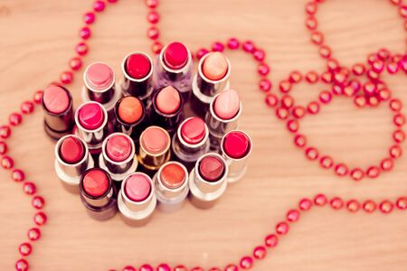 collection of lipsticks and fashion necklace Stock Photo - 12957234