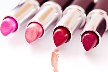 aligned lipsticks with one red stroke Stock Photo - 13230592