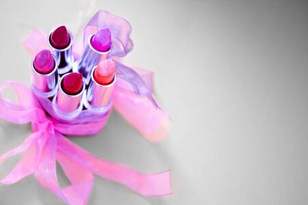 a set of lipstickslipglosses with decorative bows photo
