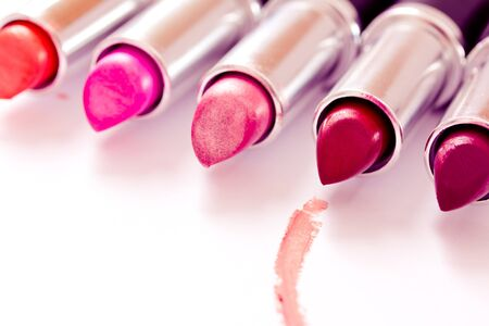 aligned lipsticks with one red stroke photo