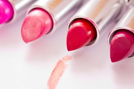 aligned lipsticks with one red stroke Stock Photo - 13241135