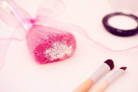 make up brushes and white eyeshadow
