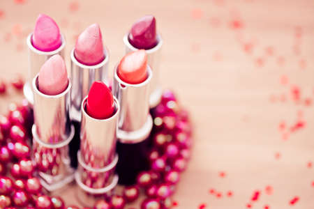 lipsticks colors with red necklace photo