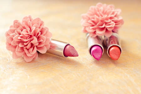cosmetic products: lipsticks colors with flower petals