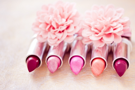 lipsticks colors with flower petals Stock Photo - 13865002