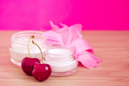 concept of organic cosmetics, lotions and cherries