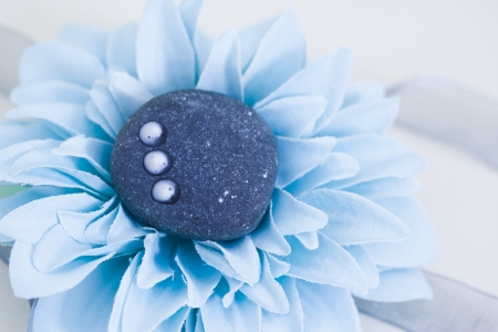 natural beauty care: spa stone, lotion and petals photo