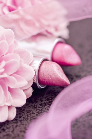 pink lipsticks and flower petals