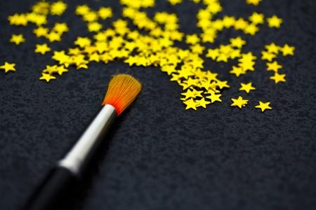 uniqueness: brush creating stars on black: uniqueness, talent