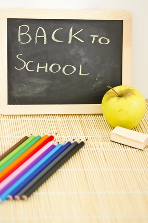 blackboard and coloured pencils, back to school concept photo