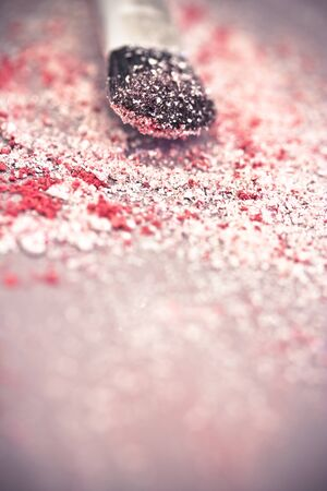 macro of eyeshadow powder and brush photo