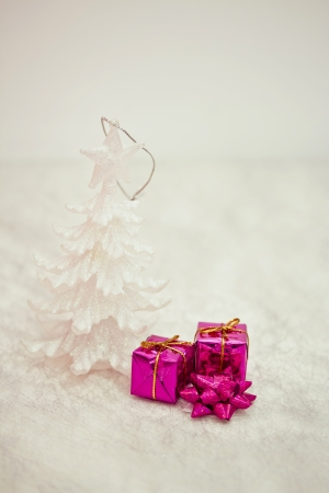 xmas decorations on pink with snow texture photo