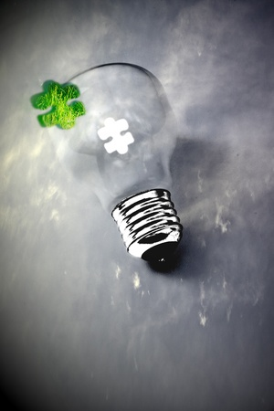 green jigsaw puzzle piece to complete lightbulb photo