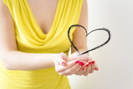 femal: femal hands holding design of heart
