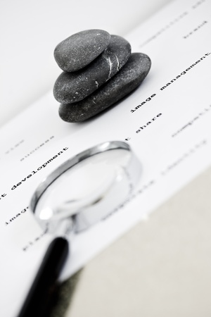 zen stones stacked surrounded by business words photo