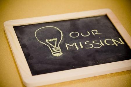 pr: lighbulb and business mission chalk design on blackboard