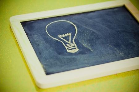 pr: lighbulb design on blackboard, metaphor of innovation Stock Photo
