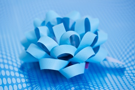 beautifully wrapped: macro of a present beautifully wrapped in blue Stock Photo