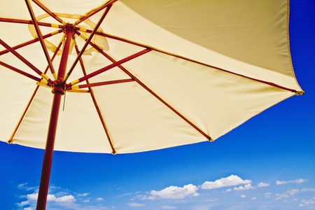 tropical holiday resort destination with beach umbrella over bright sky