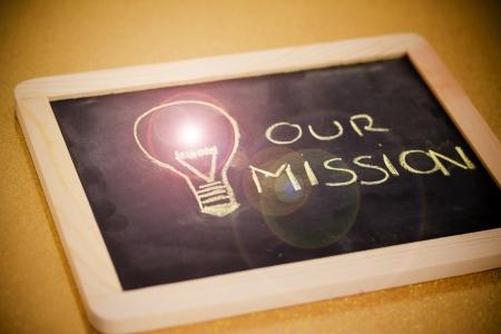 lighbulb and business vision chalk design on blackboard photo