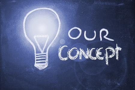 lightbulb and business concepts chalk design on blackboard photo