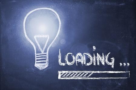 design of lightbulb and progress bar on blackboard, loading    photo