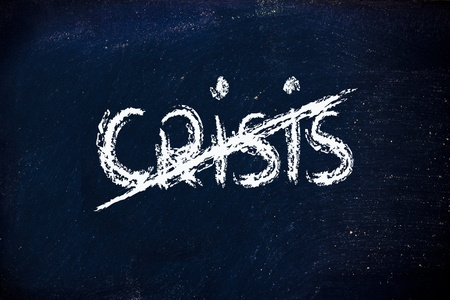 crisis end writing on blackboard photo