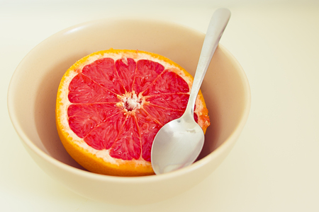 healthy fruit series  pink grapefruit in a bowl and spoon Stock Photo