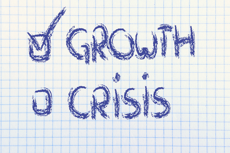 paper notebook with writings about the economic crisis and new growth photo