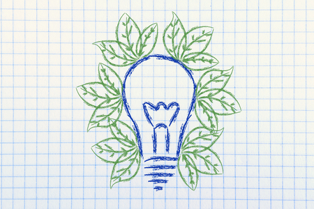 green leaves growing inside lightbulb, symbol of new ideas for the green economy and reneweable energy Stock Photo