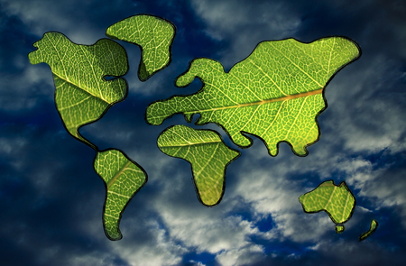 green economy and sustainable deveolpment, green leaves over continents photo
