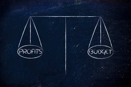 a balance measuring the relationship between budget and profits photo
