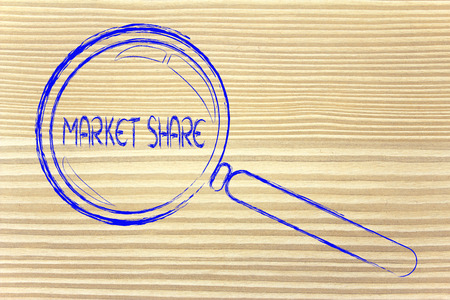 magnifying glass seeking or focusing on market share photo